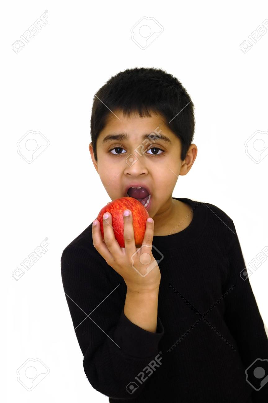 An handsome indian kid holding a red apple Stock Photo - 827636