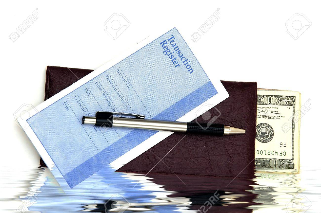 a check book transaction register and some money against a white