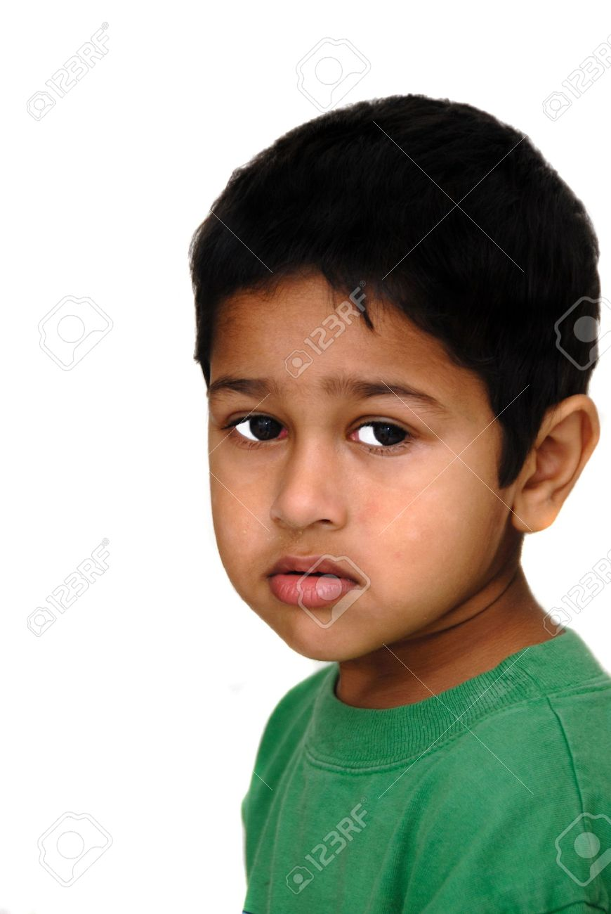 young asian indian kid looking very sad stock photo picture and