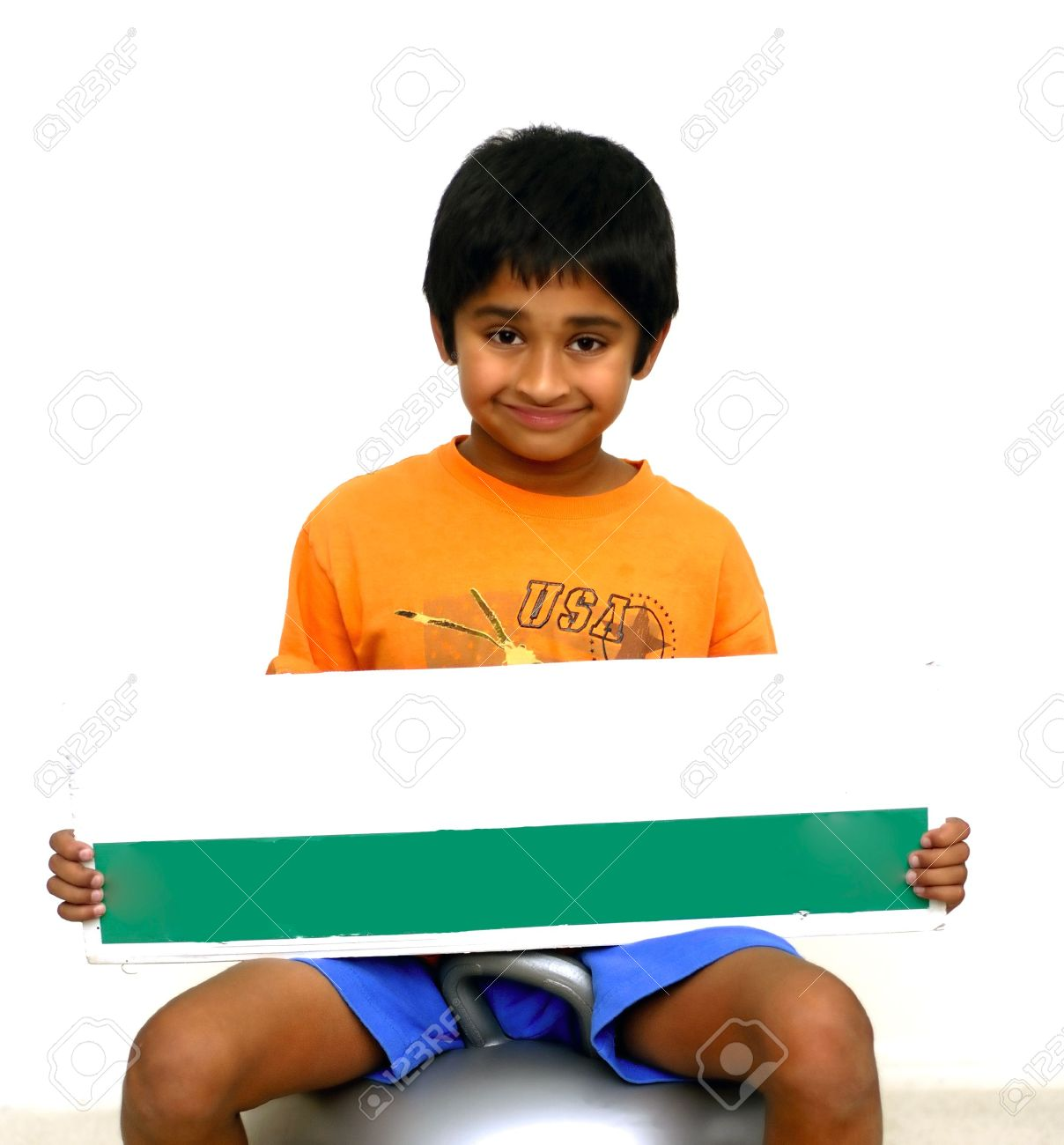 An handsome Indian kid holding a sign board Stock Photo - 2376111