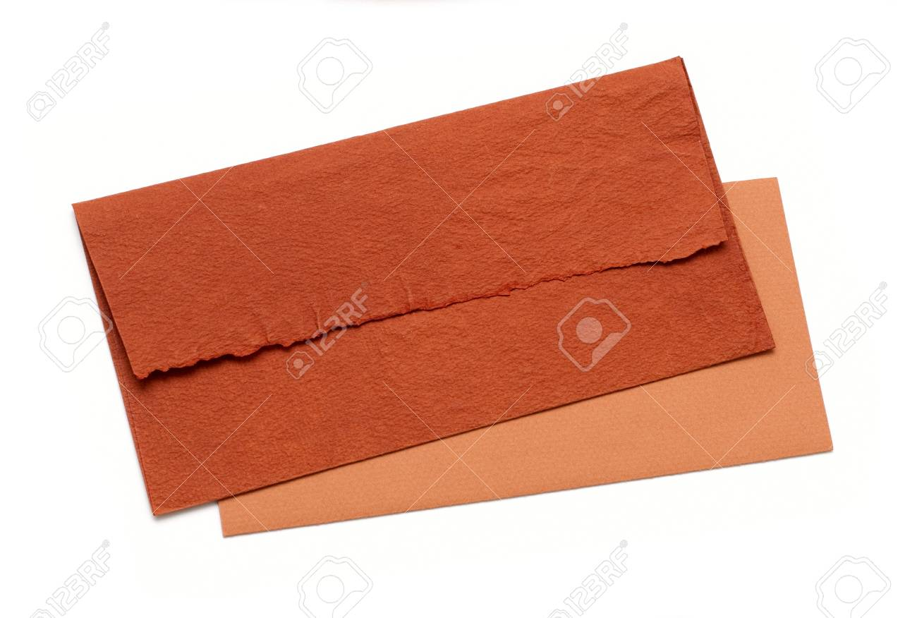 orange envelope by hand on a white background Stock Photo - 9449030