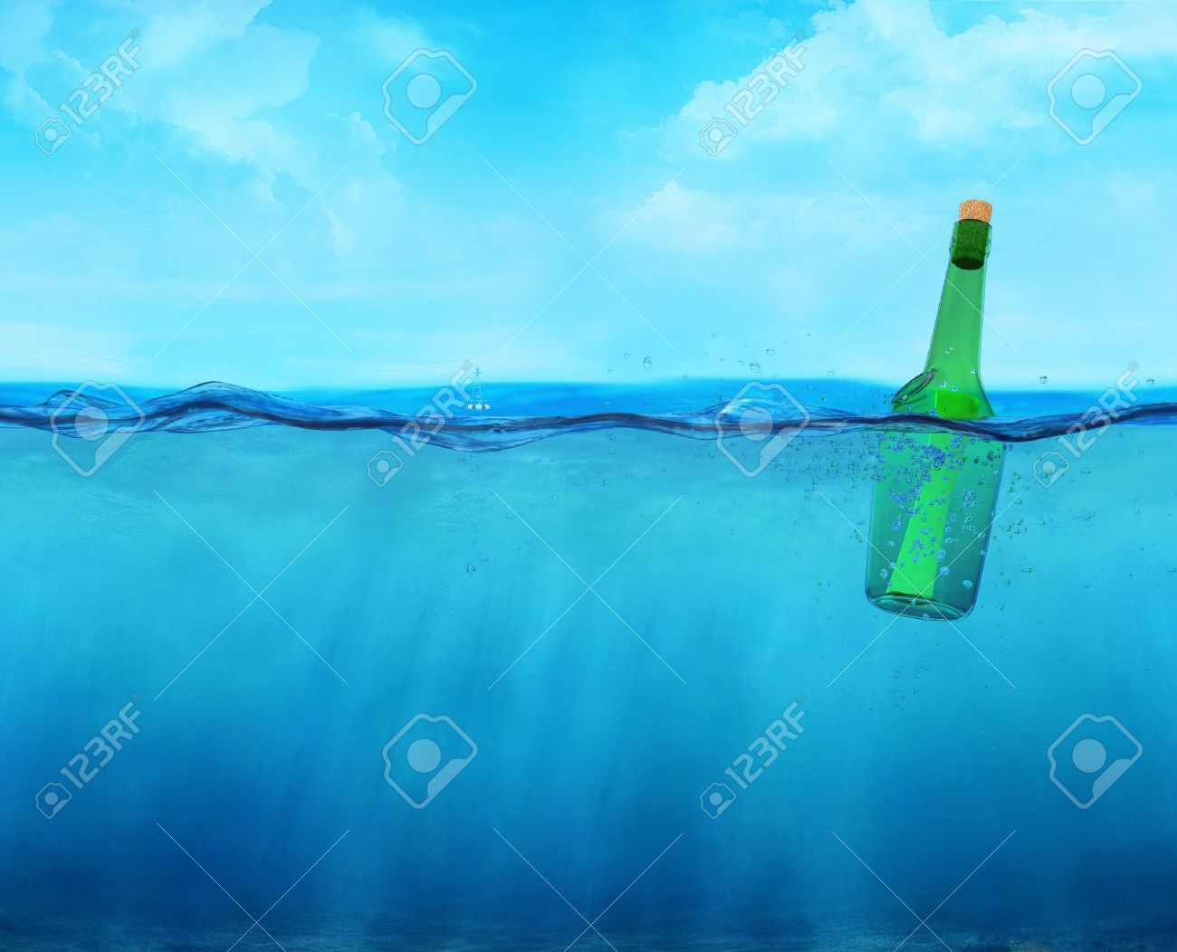 3d floating bottle with message on the ocean waterline view Stock Photo - 11648359