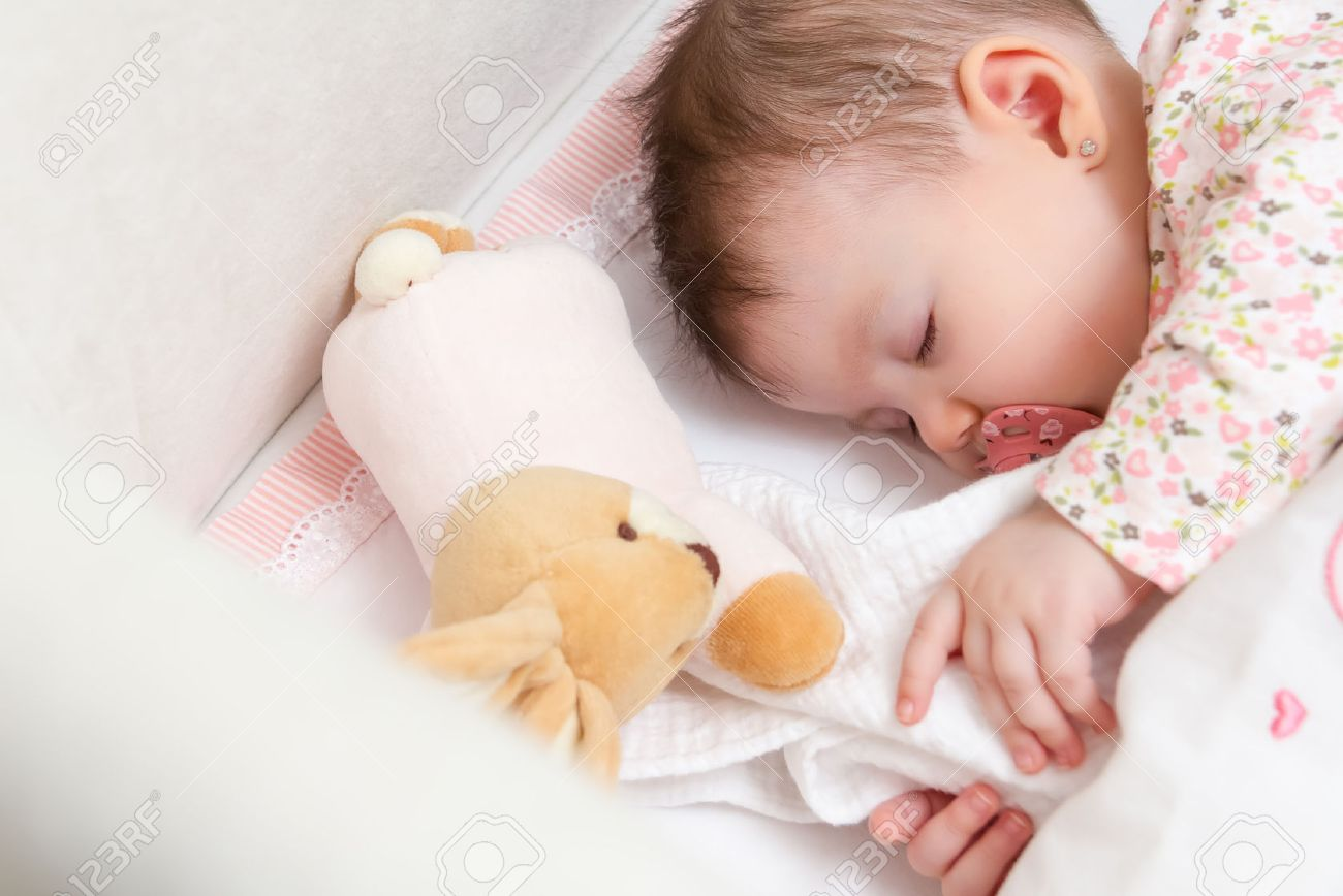 1416d6623f39 Portrait Of Cute Baby Girl Sleeping In A Cot With Pacifier And ...