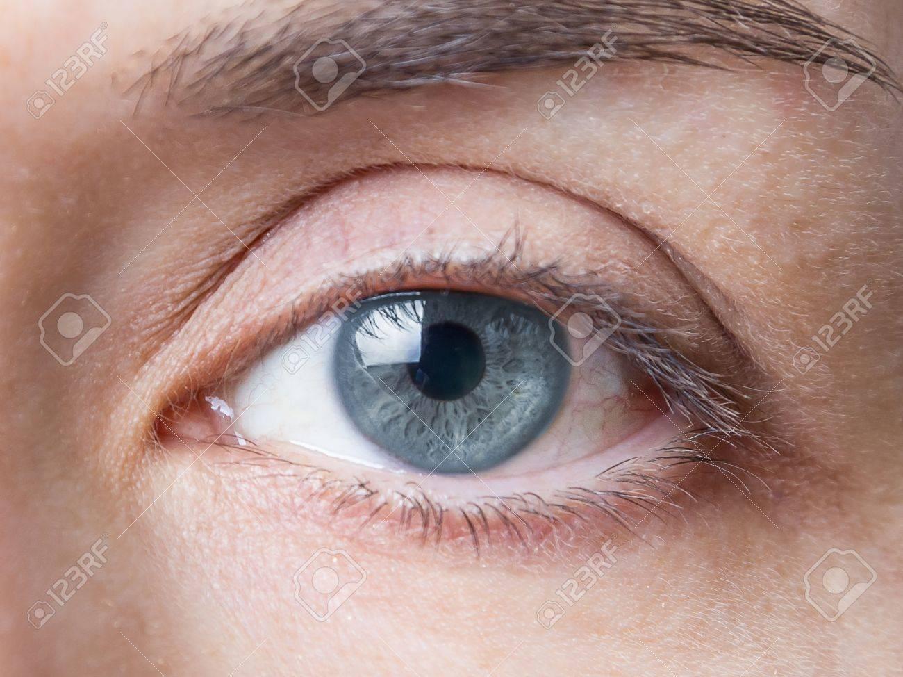 Closeup Of Beautiful Female Natural Blue Eye Without Makeup Stock