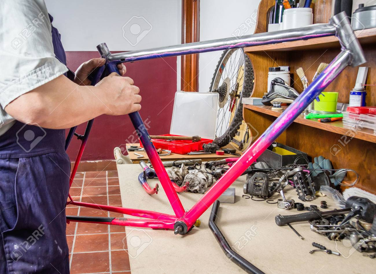 Hands Of Real Bicycle Mechanic Cleaning Damaged Frame Bike In ...