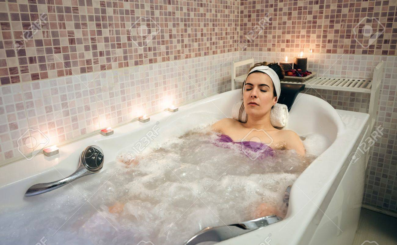 Young Beautiful Woman With Turban Lying In Tub Doing Hydrotherapy ...