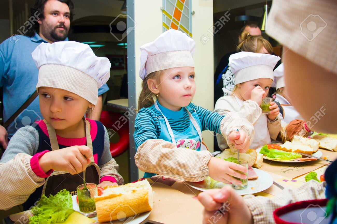 Alchevsk, Ukraine - November 8, 2018: children in the form of cooks prepare sandwiches. - 138122603
