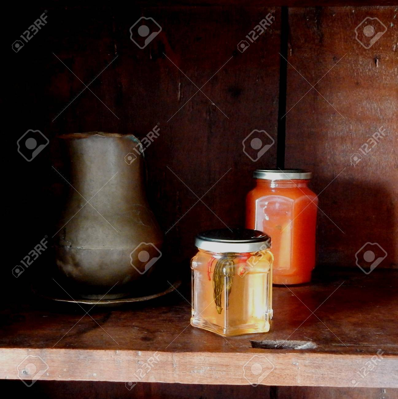 Tropical jellies and tin jar in closet wooden rustic - 67646790