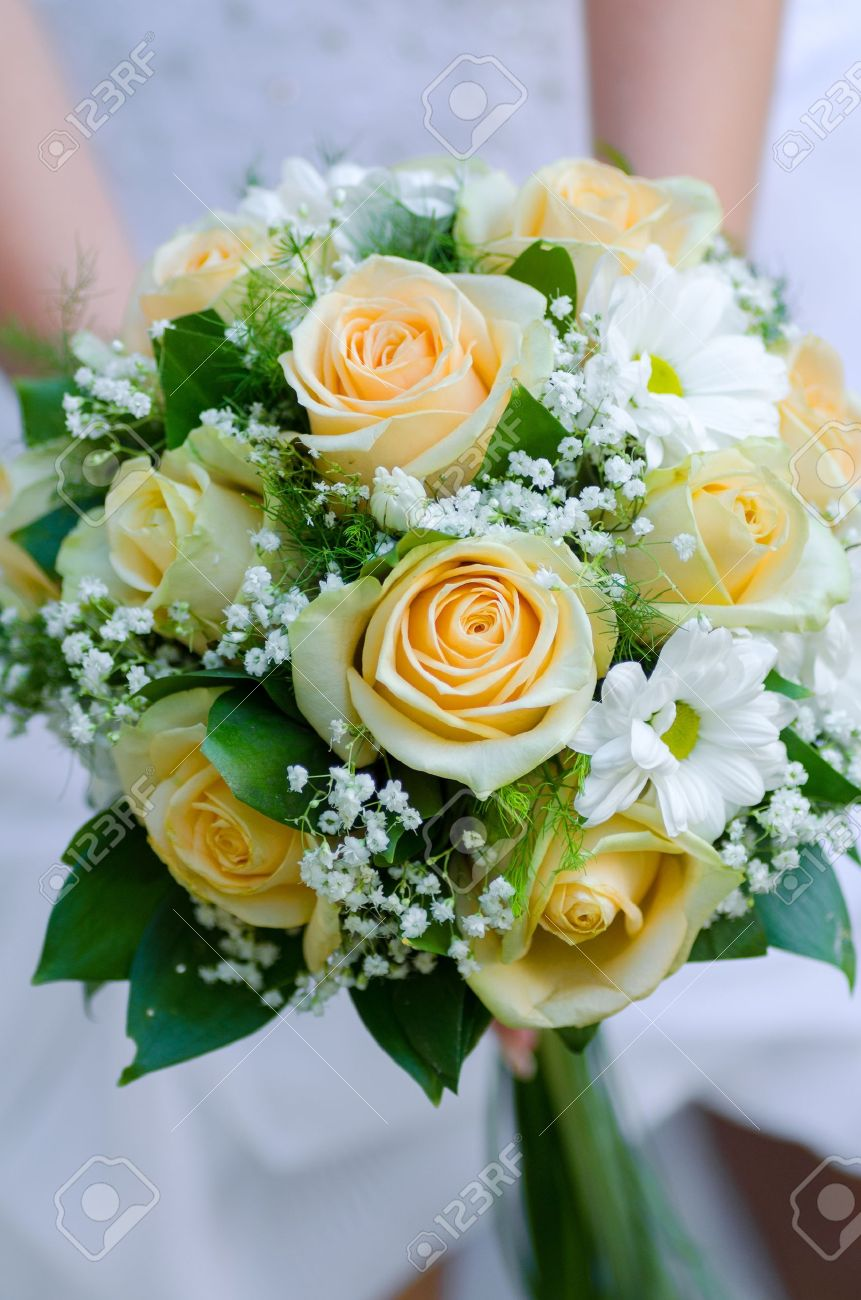 Bride Holding Beauty Wedding Bouquet Of Yellow Roses And White