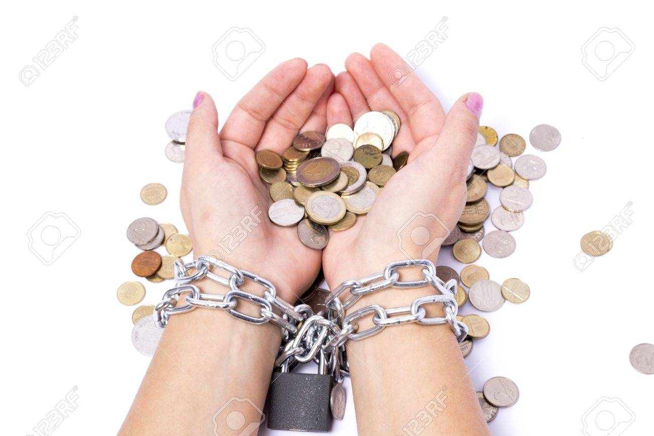 hands chained to the bank the money saved to startup Stock Photo - 11070216