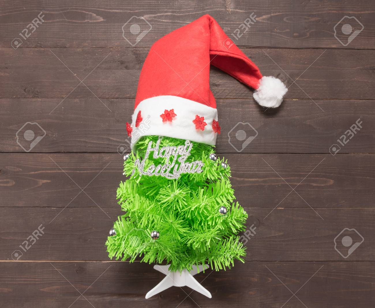 Christmas Tree With Happy New Year Massage And Red Hat Are On ...
