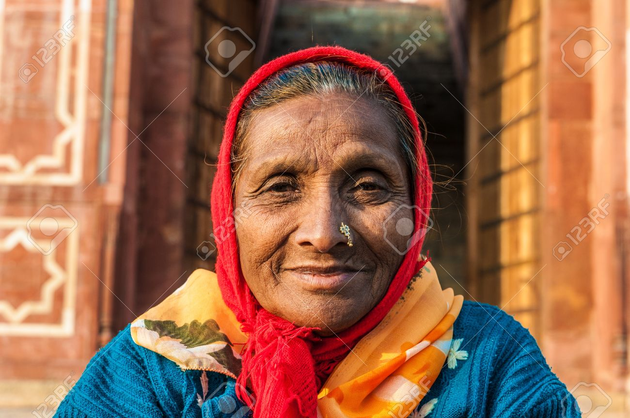 An old woman with a nose ring and a red scarf in Delhi, India Stock Photo - 14581262