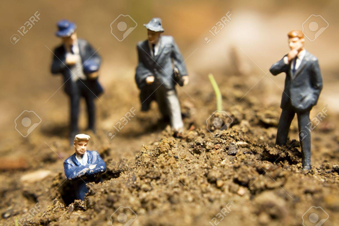 Business figurines placed outside in the dirt Stock Photo - 7236896