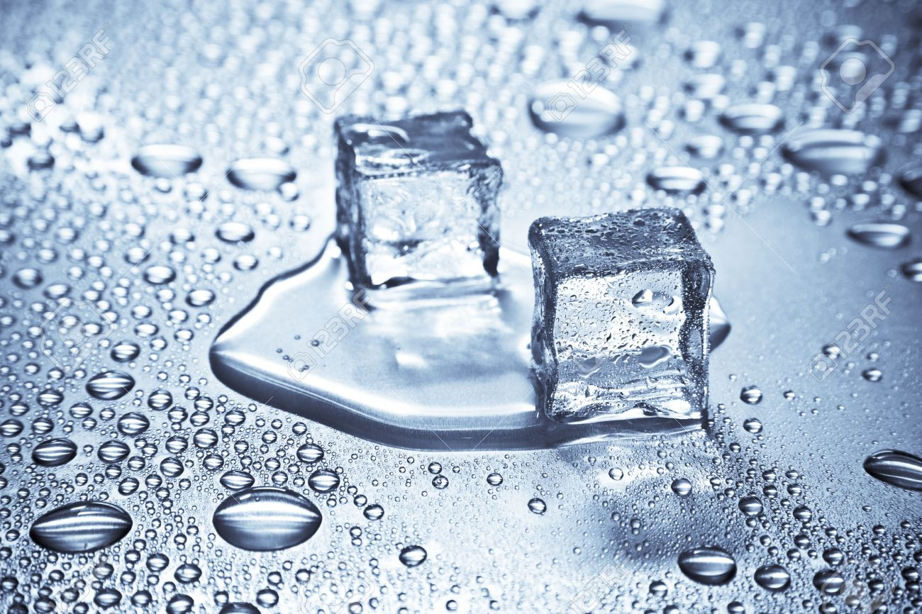 Melting Ice Cubes On A Metal Tabletop Stock Photo   7236903