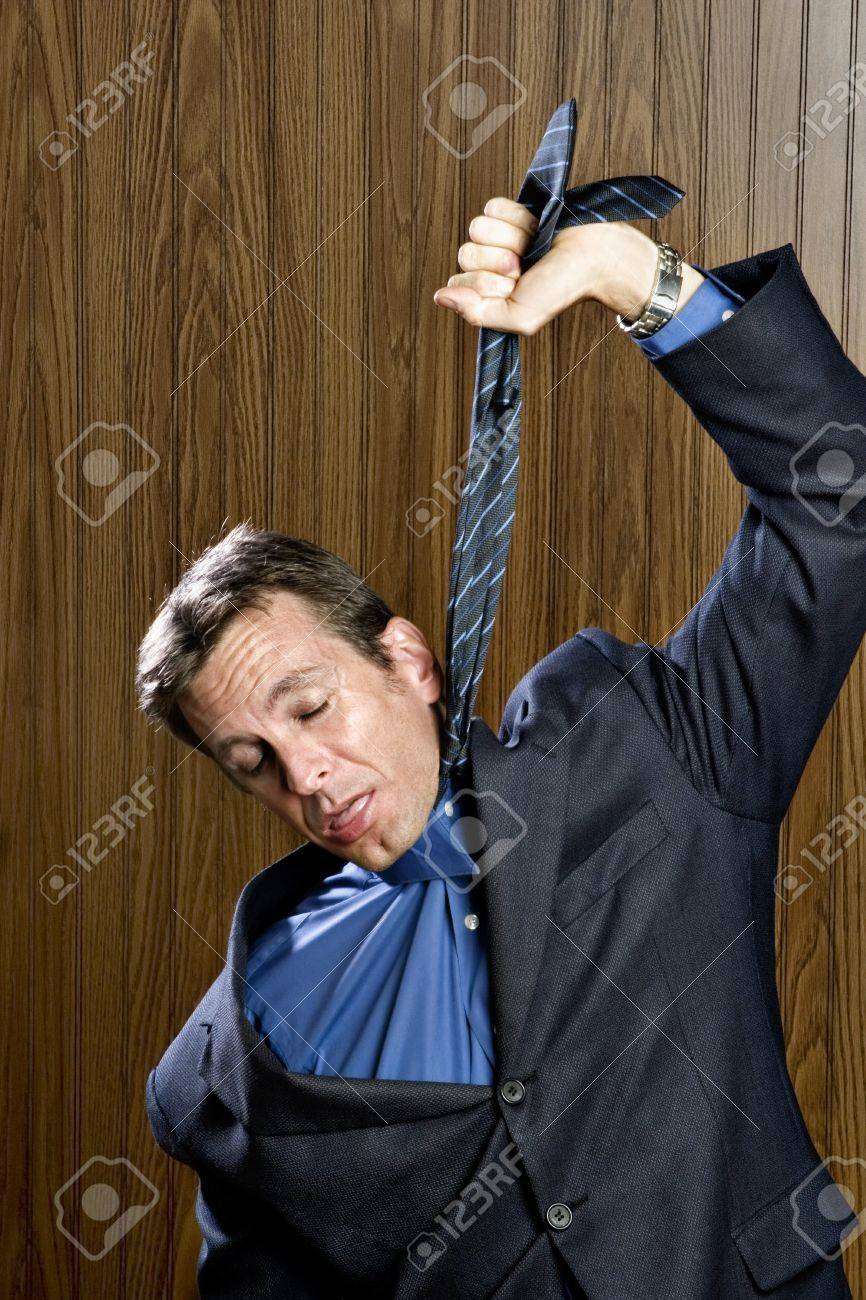 Businessman hanging himself with his necktie Stock Photo - 7710167
