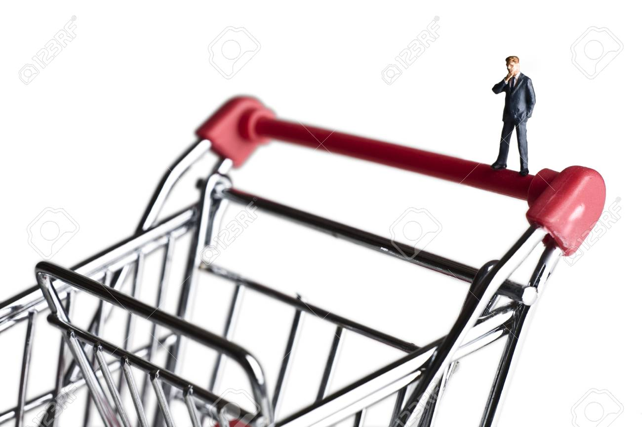 Businessman figurines on a shopping cart Stock Photo - 7792776