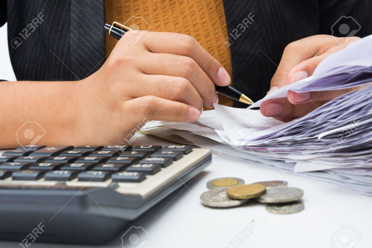 Closeup woman working with receipts Stock Photo - 17872574