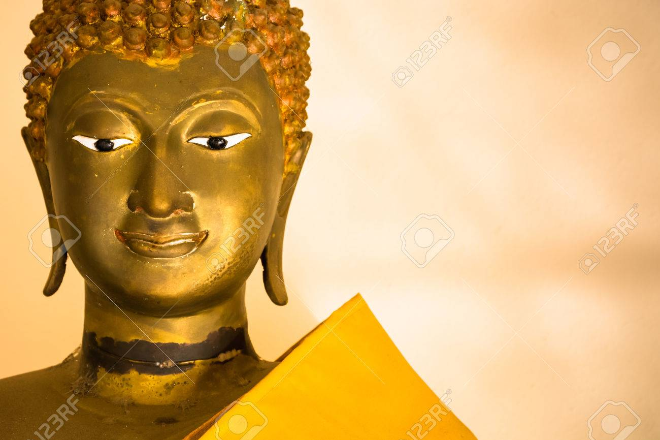 Closeup Buddha Face Statue On White Wall Stock Photo, Picture And ...
