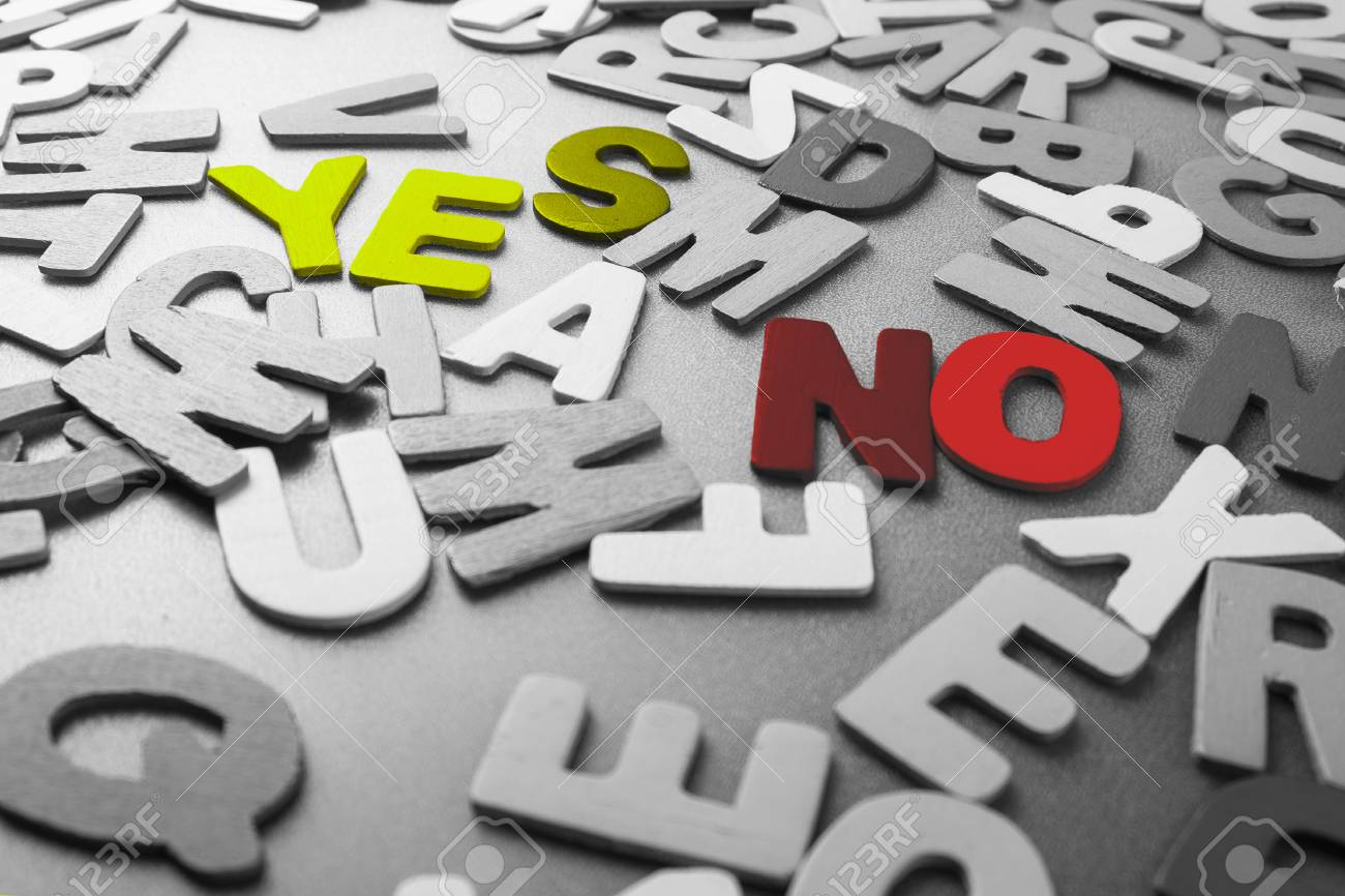 Color Yes And No Word In Scattered Black And White Wood Letters