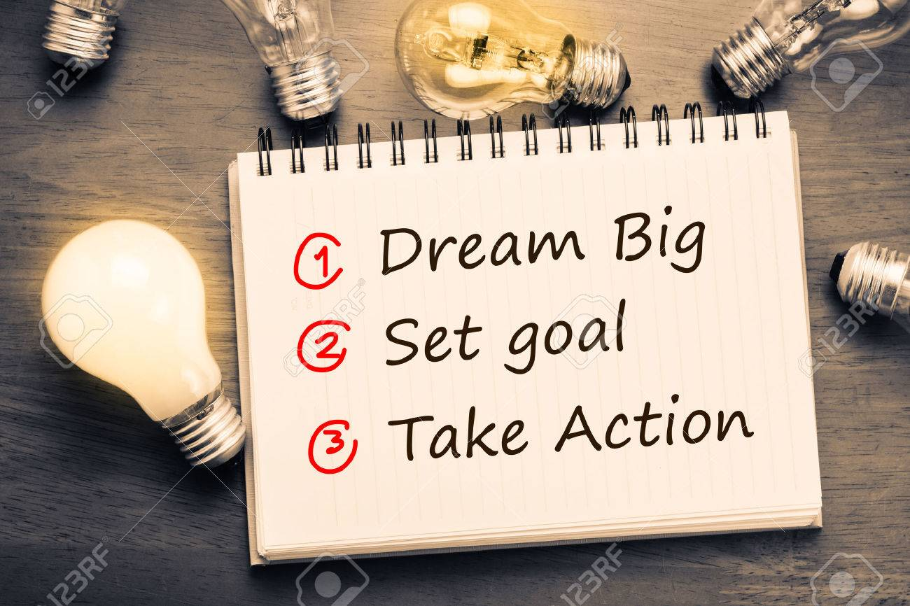 Dream Big - Set Goal - Take Action, handwriting on notebook with