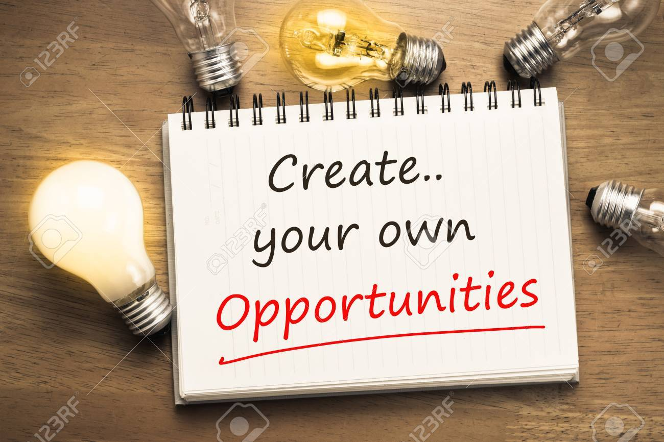 create your own opportunities as motivated memo on notebook with light bulbs stock photo 48937854