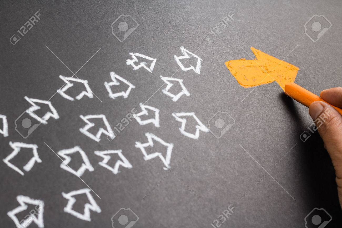 Hand drawing orange arrow as trend leader with many white arrows as follower - 50478200