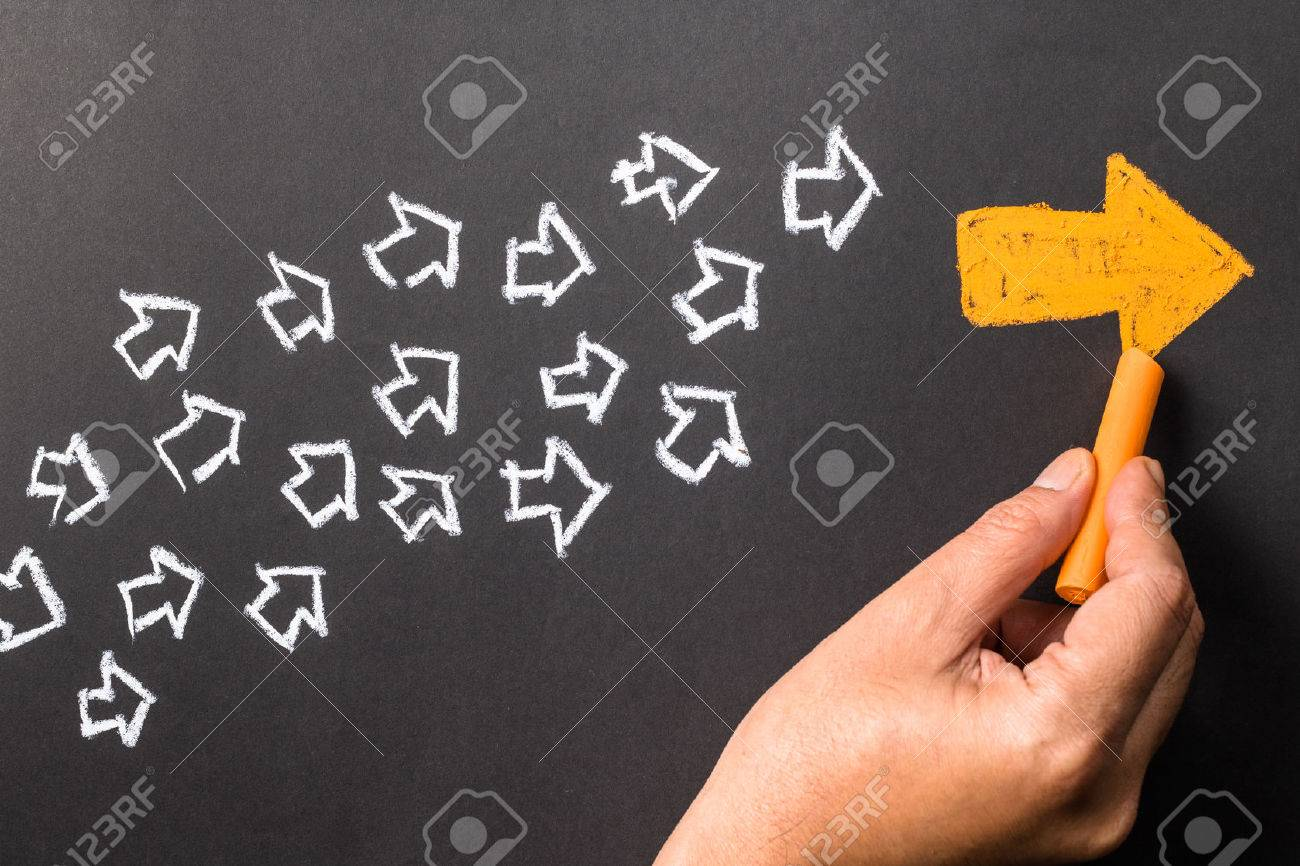 Hand drawing orange arrow as trend leader with many white arrows as follower - 50478712