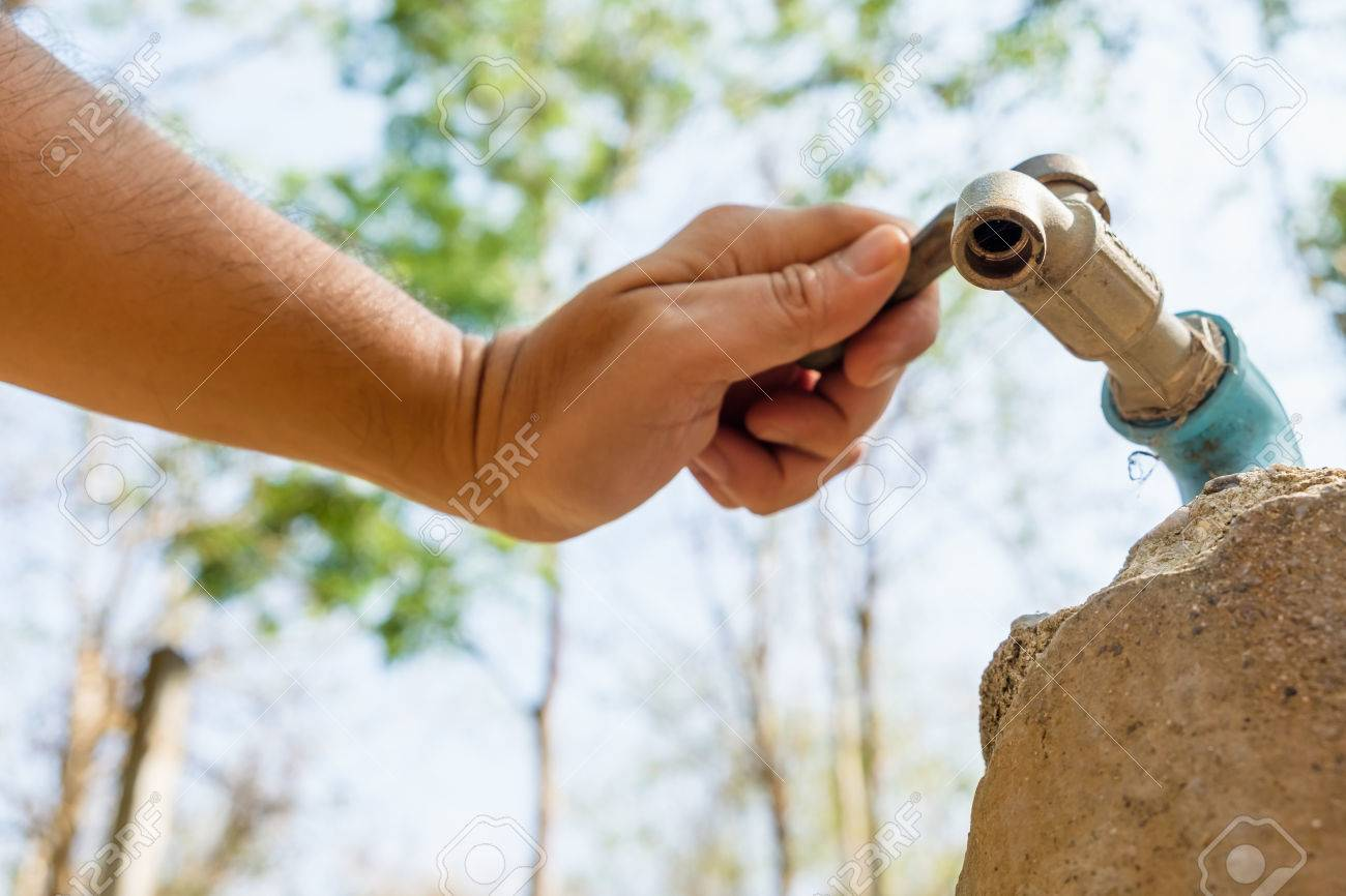 Hand Try To Turn On Old Faucet Outdoor In The Forest But No Water ...