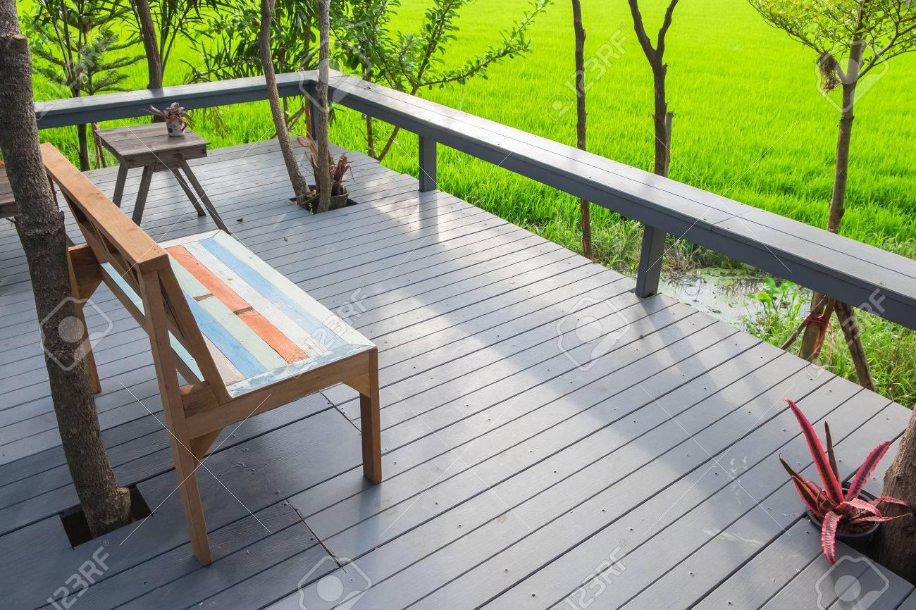 relax corner backyard porch beside rice field with sunlight stock