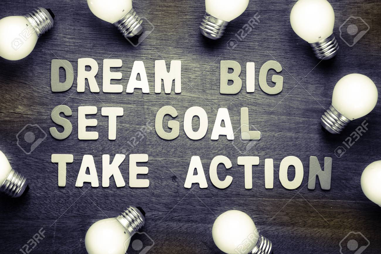Dream Big - Set Goal - Take Action text with many light bulbs