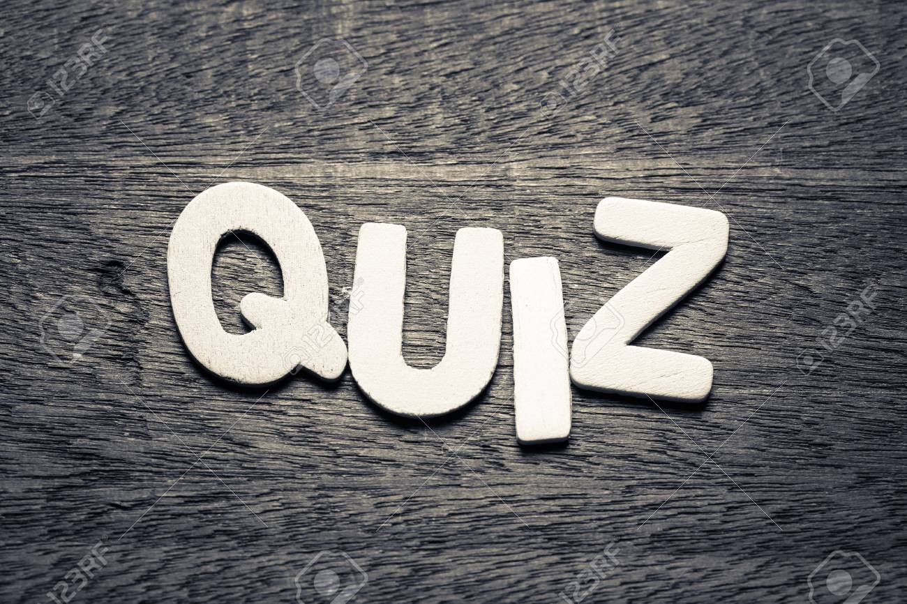 Quiz word by wood letters on wood background