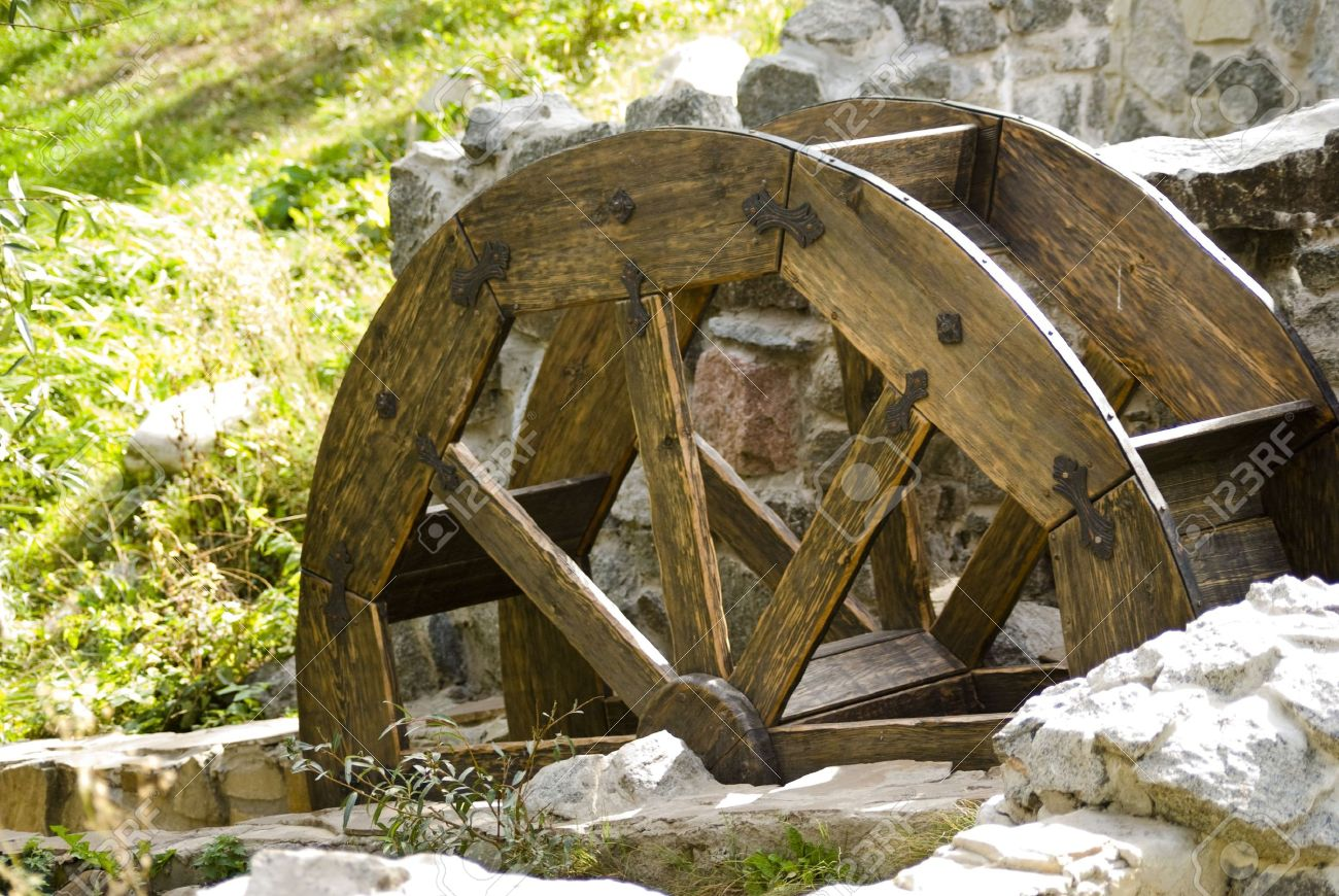 Old watermill with a wooden wheel and stone walls - 5793169