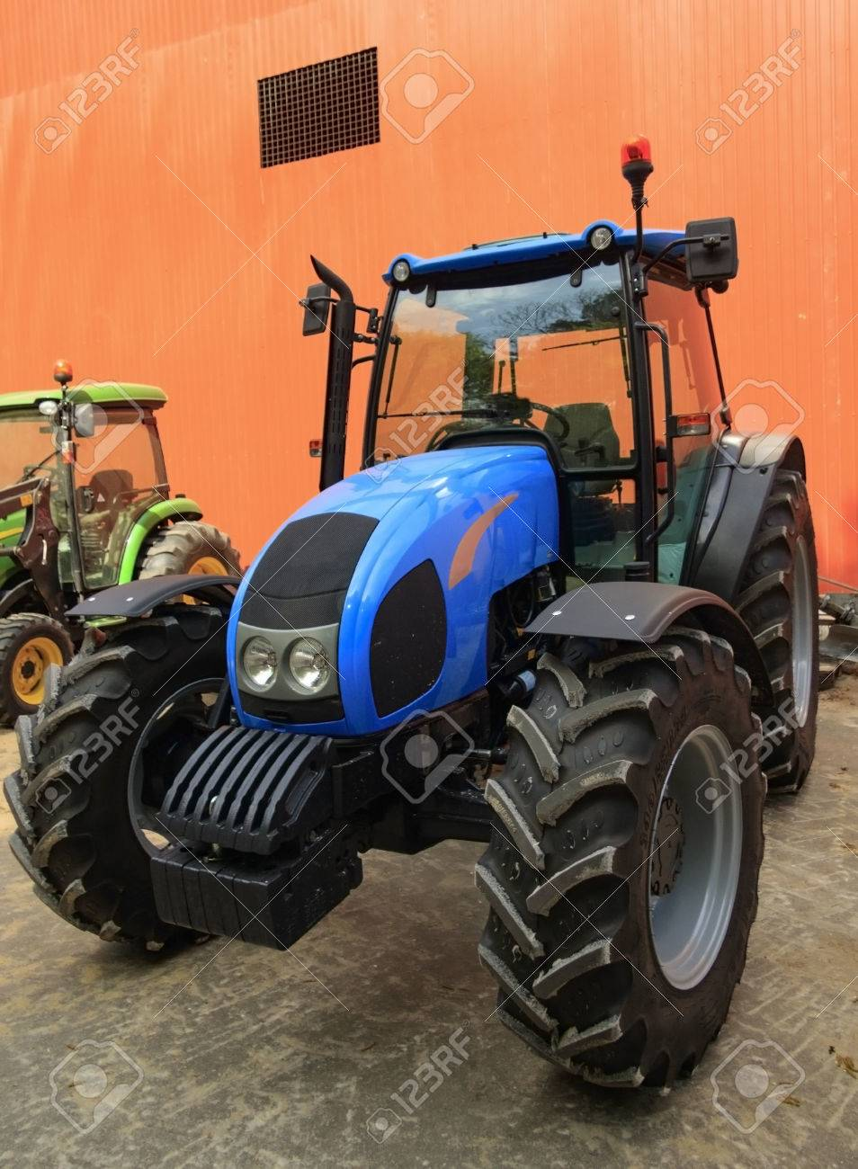 Tractor in the yard of the farmer - 78004716