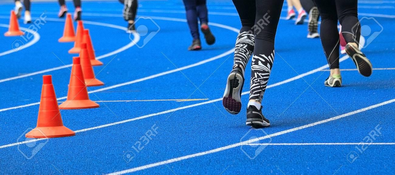 Treadmill at the stadium and athletes. - 79188696