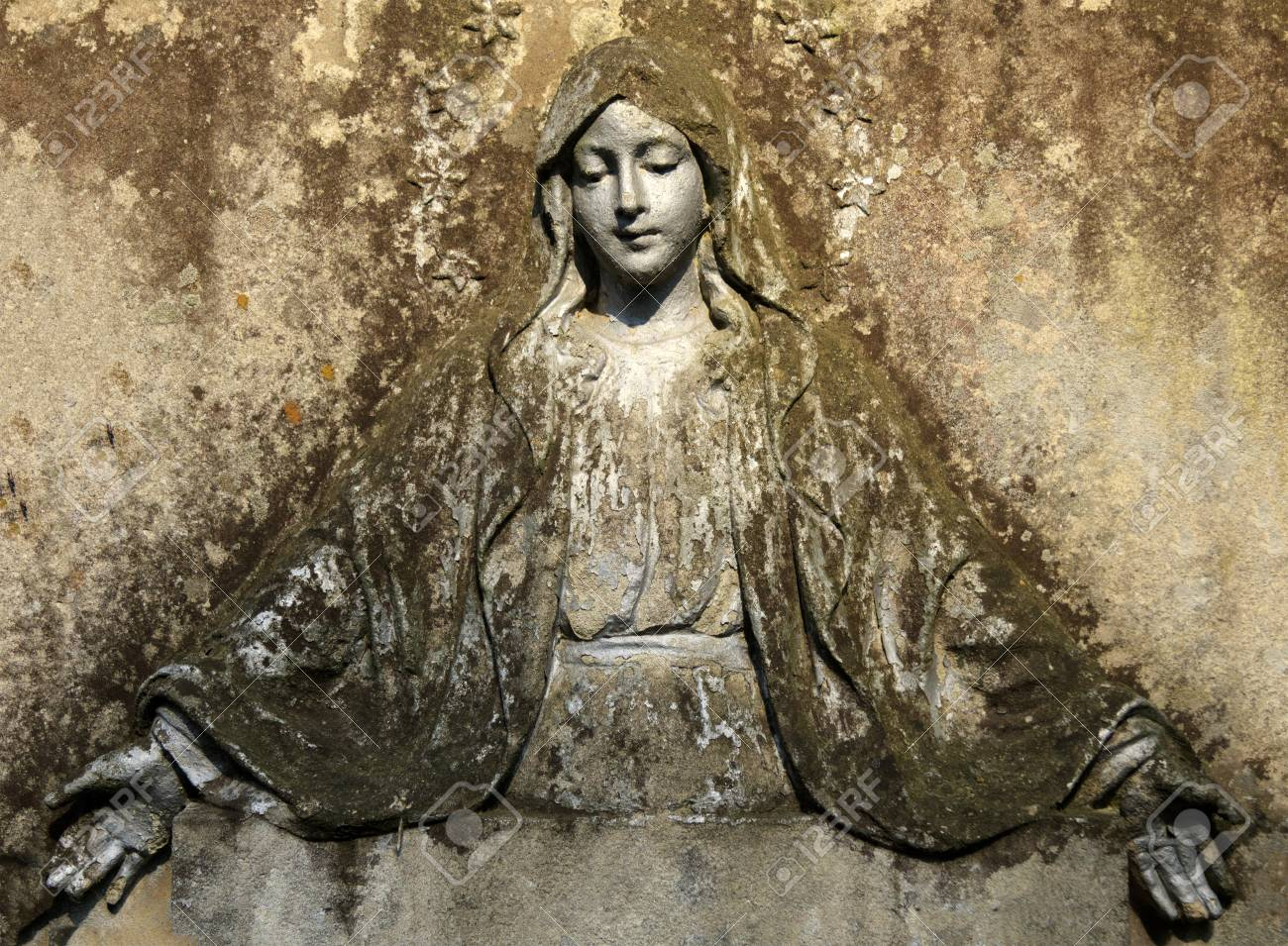 Madonna on a stone fresco. - 84851395