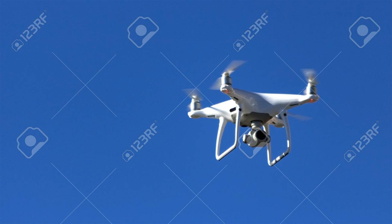 drone on a background of blue sky - 104003863