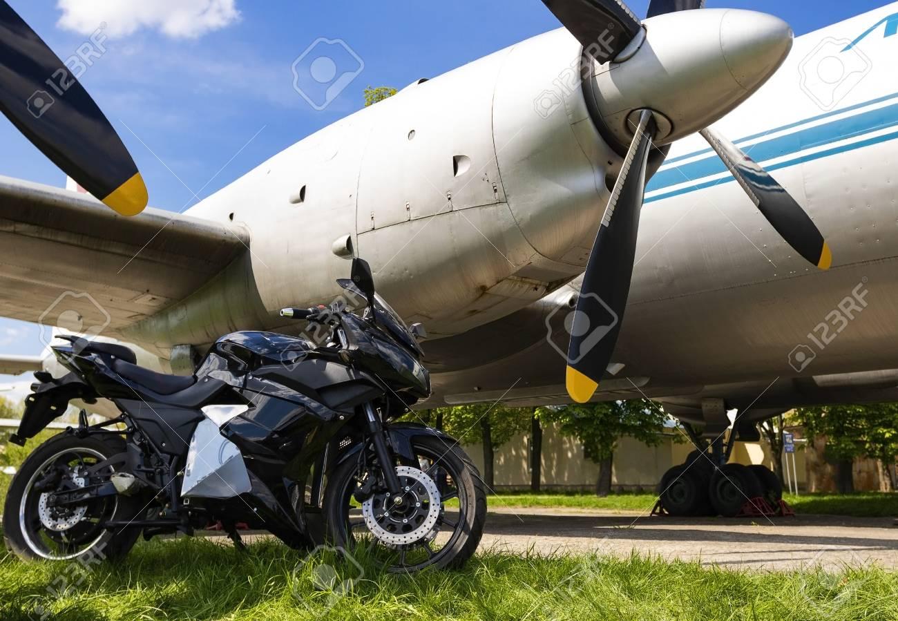 Ukraine, Kiev April -27 2018:Sport bike on the background of an old airplane.Kiev April-27 2018 - 107230327