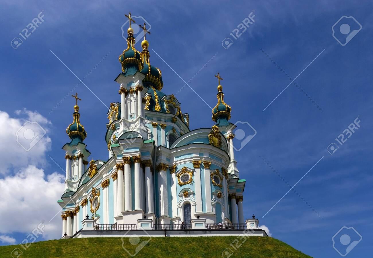 Kiev. Andreevskaya church against the blue sky. - 136888108