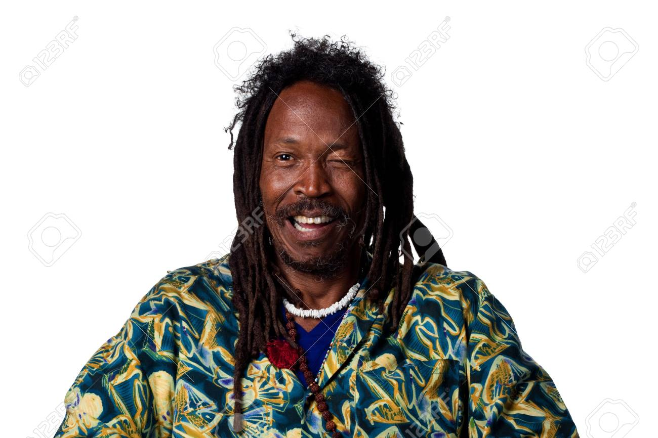 Rastafarian man winking at the camera, isolated on white Stock Photo - 6908839