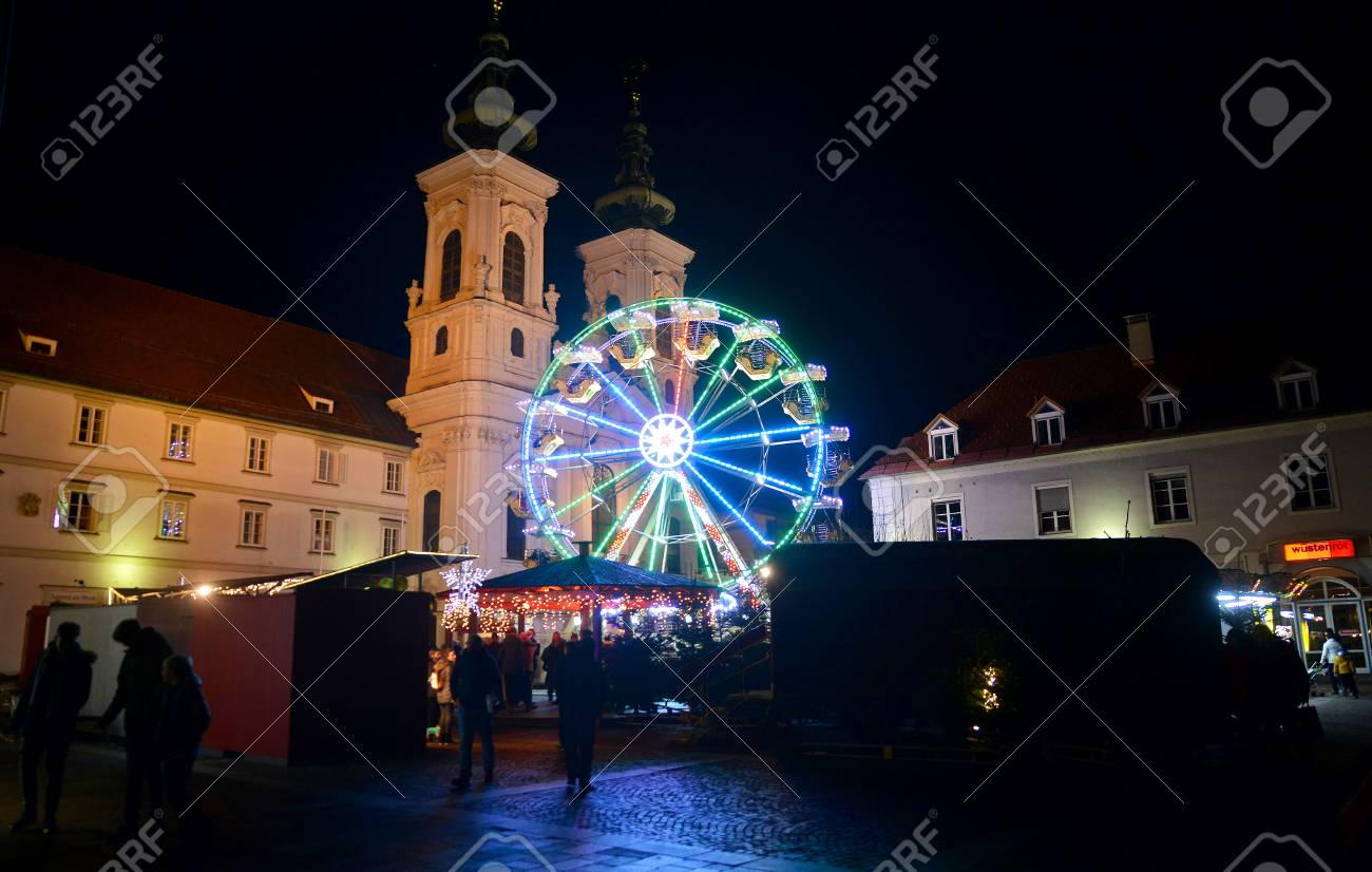 GRAZ, AUSTRIA - DECEMBER 17., 2017: Christmas decorated town of Graz during advent and holidays in December. - 93041413