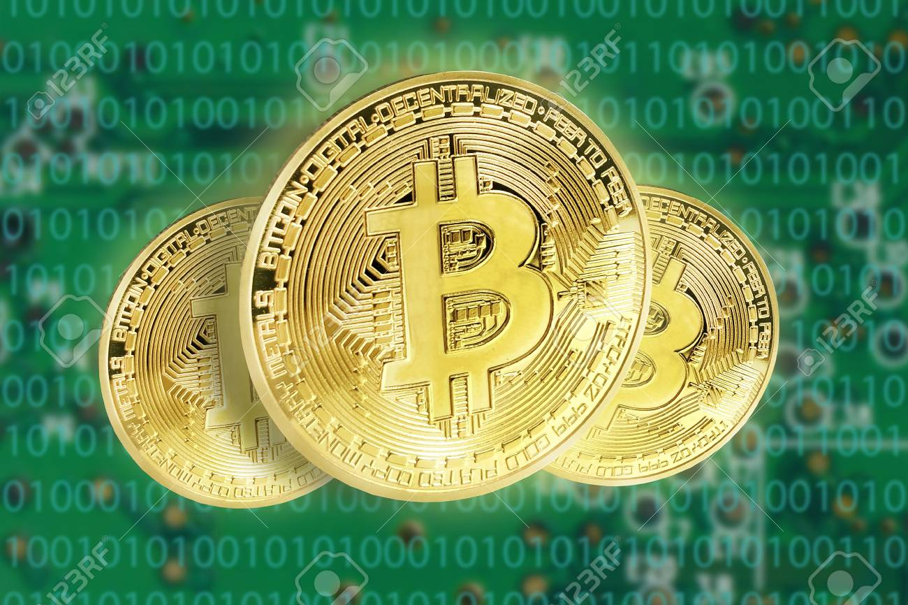 Bitcoins concept with electrical circuit in the back - 93970383