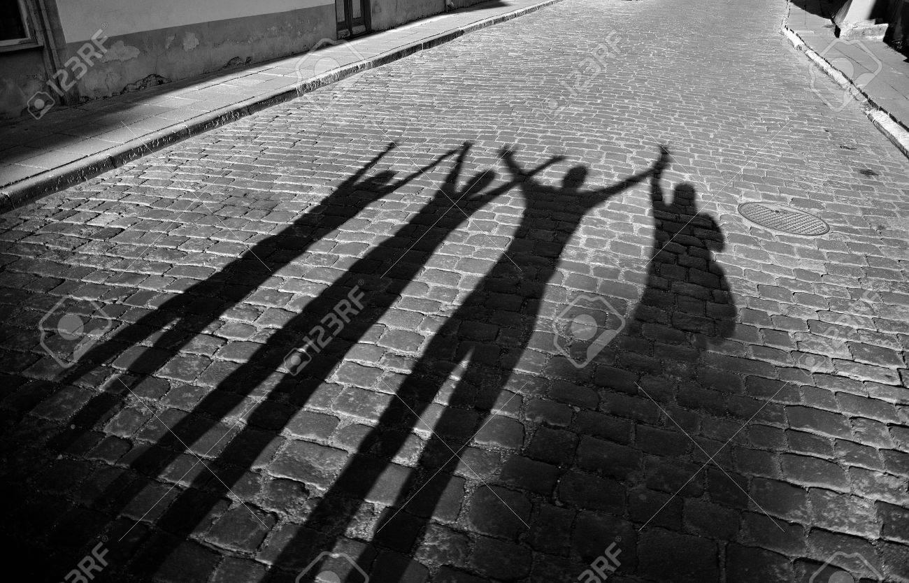 Four shadows jump on roadway Stock Photo - 15355133