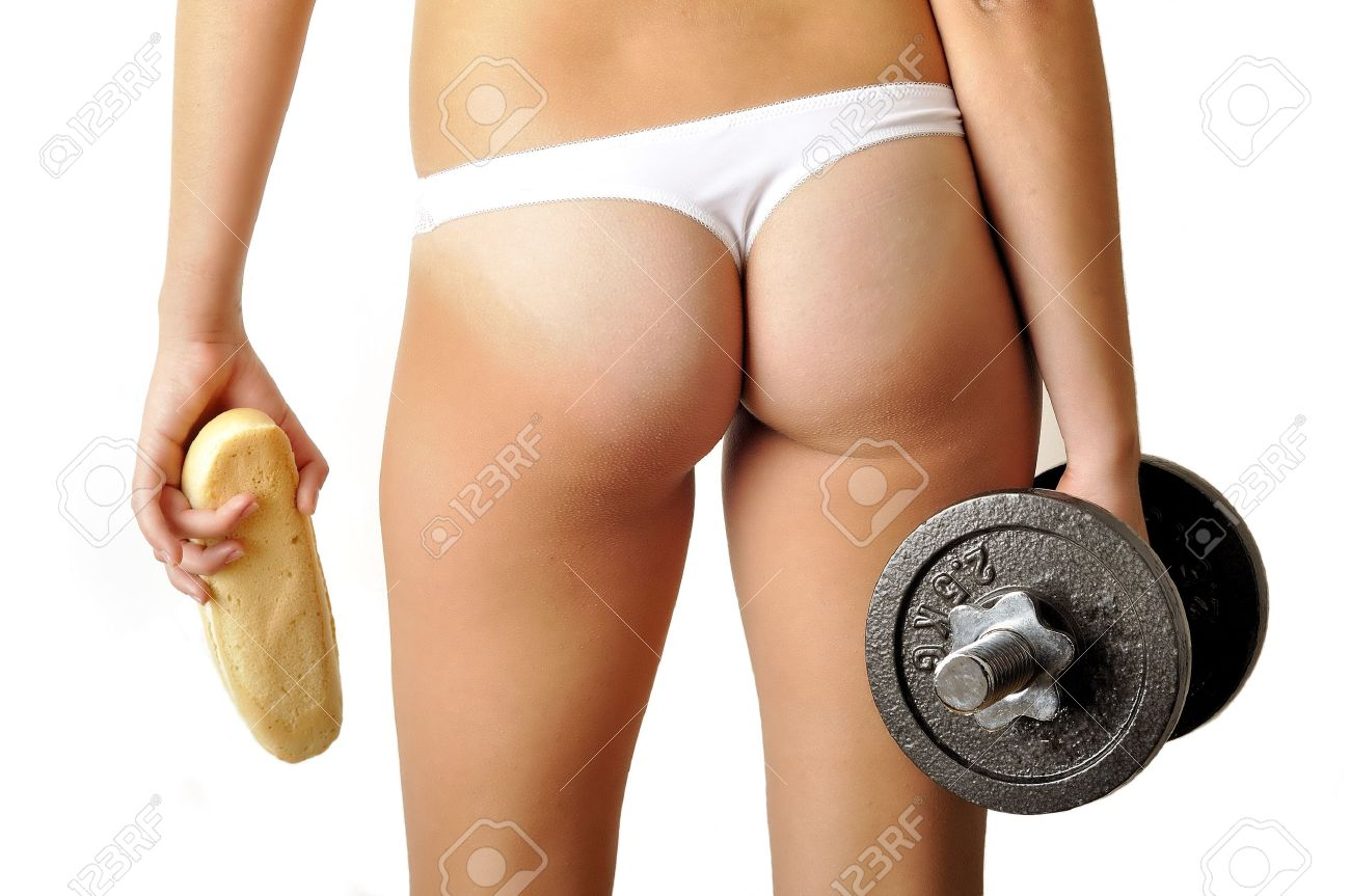 Girl Ass With Two Hands Holding Dumbbell And Long White Loaf Stock ...