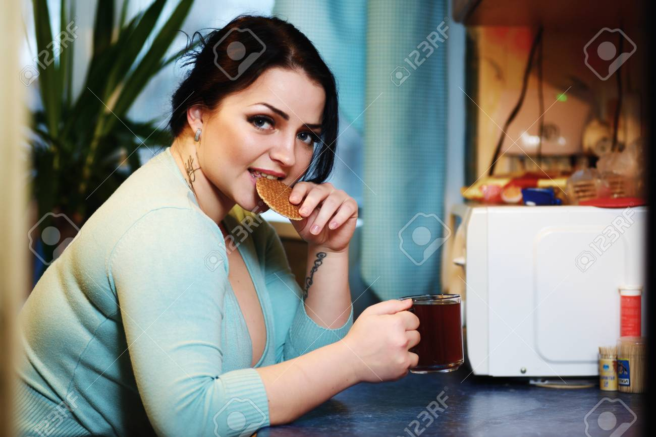 Young Beautiful Housewife Drinking Tea In Kitchen Stock Photo ...