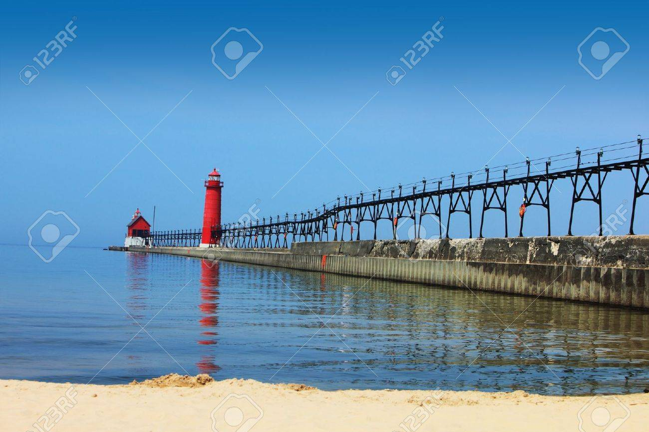 Lighthouse and Pier Grand Heaven Michigan in the summer time Stock Photo - 7054626
