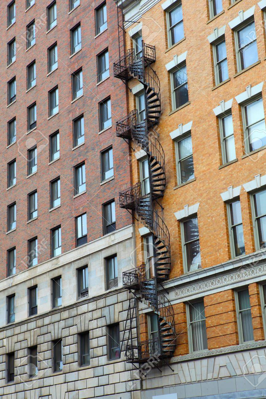 Spiral Staircase Between Two Brick Walls On Building Stock Photo