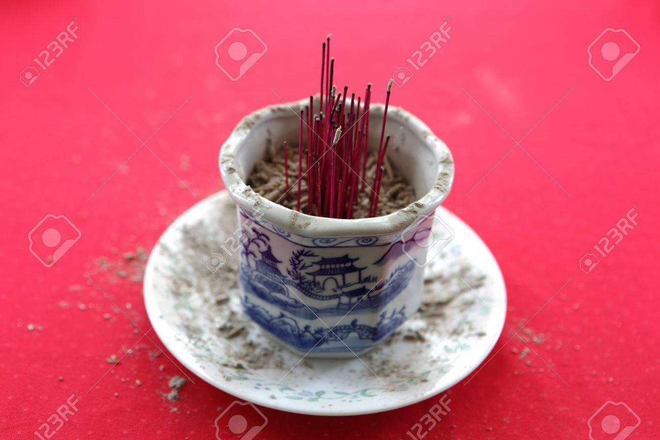 Burnt joss incense sticks in the holder Stock Photo - 18269746