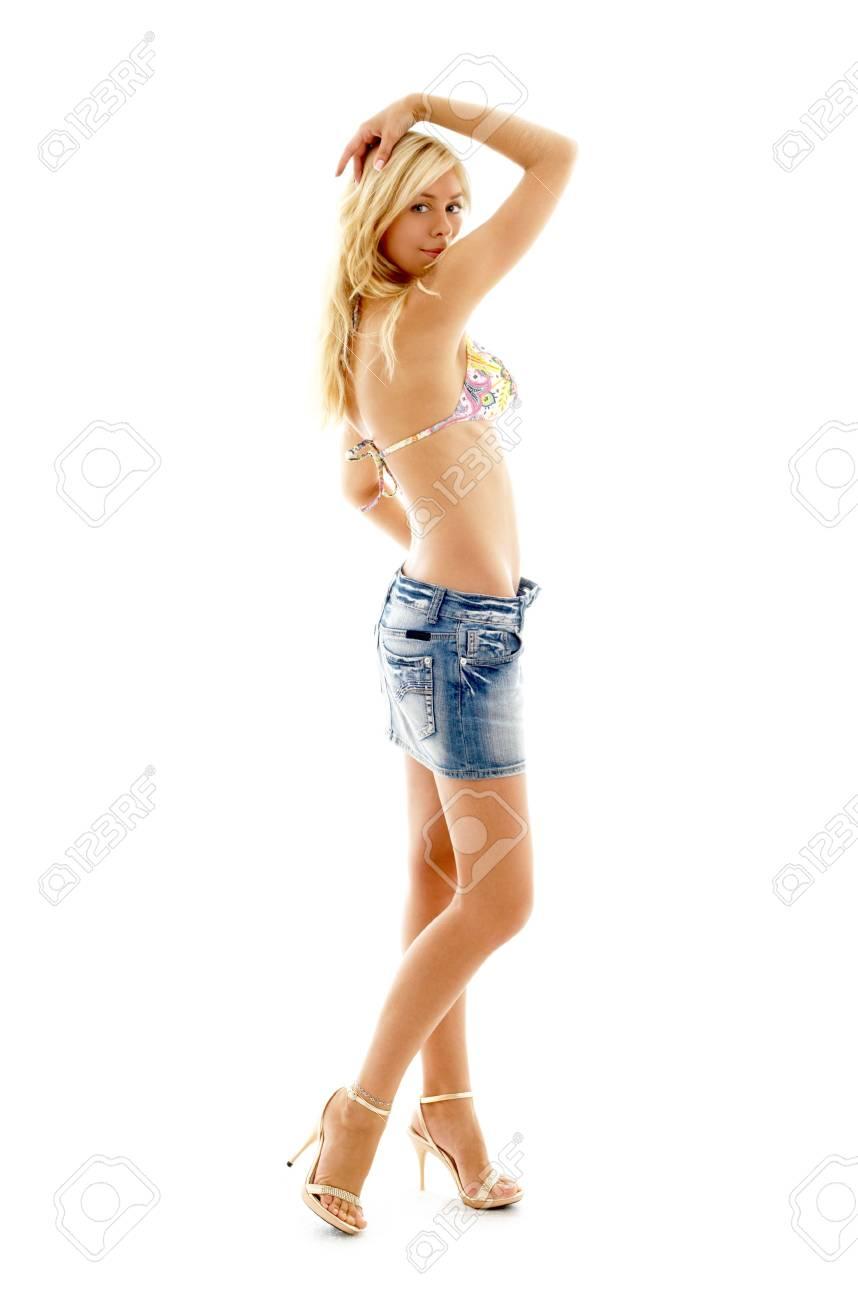 pretty blonde in denim skirt and colorful bikini over white Stock Photo - 603297