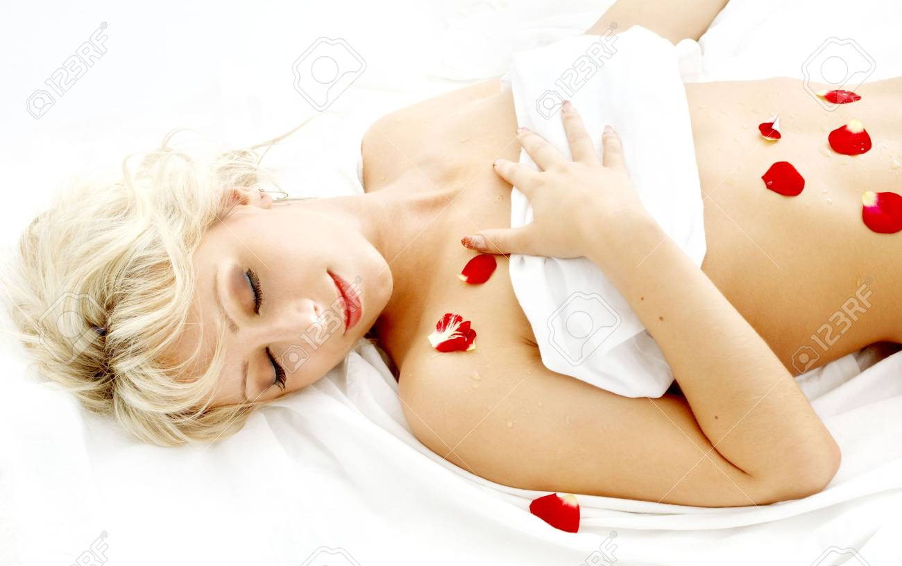 lovely blond with rose petals relaxing in spa Stock Photo - 680353