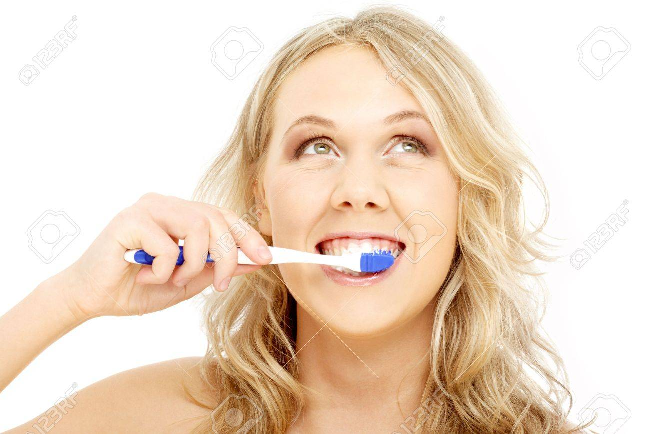 picture of happy blond with toothbrush over white Stock Photo - 837345